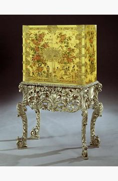 - A CHARLES II CREAM JAPANNED CABINET ON SILVERED STAND