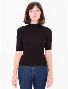 Mock turtleneck top with 1/4-length sleeve and slightly cropped length in a lightweight rayon blend.