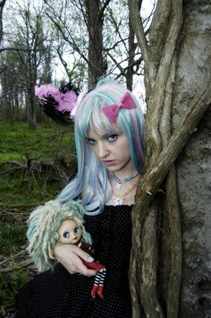 Photoshoot I did today: Gothic Lolita style. Model: Siffa Scary, with one of my customized Blythe dolls.