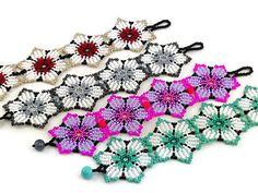 Huichol braceletFlower seed bead bracelet-using transparent beads between rows to create lines in the petals Bead Loom Bracelets, Beaded Bracelet Patterns, Jewelry Patterns, Beaded Earrings, Beaded Jewelry, Seed Bead Patterns, Peyote Patterns, Beading Patterns, Bead Loom Designs