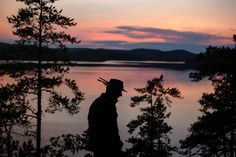 From a Canoe - Kolovesi National Park - The New York Times - Mr. Siivonen's felt fedora has raven and crane feathers tucked in its band.
