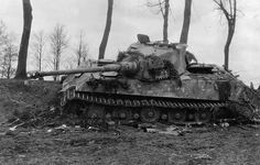 """Heavy German tank """"Tiger II"""" from s.Pz.Abt. 505, destroyed by Soviet assault aircraft on the highway between the Peise Peninsula and the city of Fishhausen"""