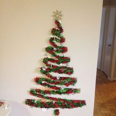 Learn how to make Cheap and Easy Christmas Decorations for Home - Tinsel Trees. You can buy all the supplies you need at your local dollar store for these awesome holiday decor ideas! Tinsel Christmas Tree, Tinsel Tree, Easy Christmas Decorations, Unique Christmas Trees, Alternative Christmas Tree, Christmas Tree With Gifts, Wooden Christmas Trees, Simple Christmas, Christmas Diy