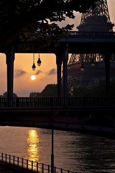 Paris elegance dark sky city lights water clouds sun