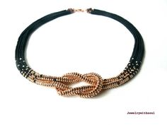 Infinity beadwoven love knot choker seed bead necklace in matte black and shiny metallic rose gold