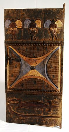 Africa | Carved wooden door from the Senufo people of the Ivory Coast.