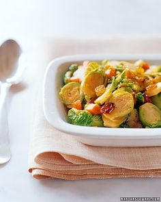 Sauteeing Brussels sprouts with carrots and raisins lends them a slight sweetness that is irresistible.