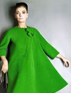 Model wearing a Pierre Cardin dress coat, 1962.