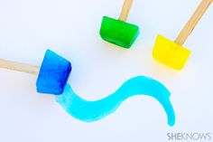 Ice cube paints - drop of paint in tray, fill w water, freeze 30 min, add stick, freeze again