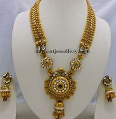 Gold Swirls Long Set with Jhumkas