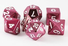 On sale now! Get ready to roll with pink metal RPG dice. These pink dice are made with real metal. Heavy in your hand, and built to last!
