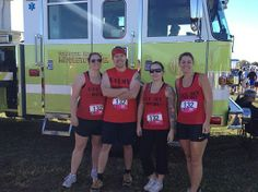 Firefighters mud run team! Great group shot with the firetruck in the background. Thanks, guys! rushordertees.com