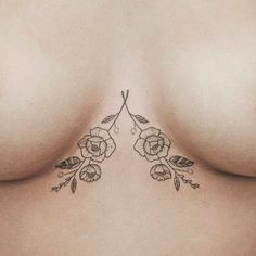 http://www.revelist.com/arts/underboob-tattoos/5179/You need these dainty flowers in your life... and under your breasts./3/#/3