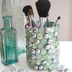 Glue on marbles from the dollar store to a fruit can or any other open can, looks fabulous for organizing make up brushes, you can also use it as a pen…