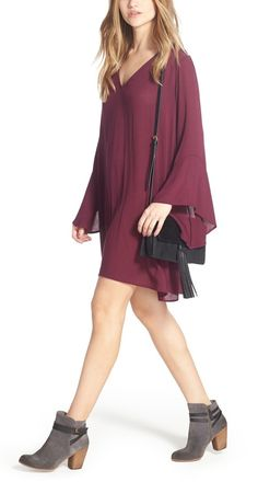 How perfect is this plum color for fall? Wrist-skimming sleeves frame this ethereal woven dress cut with a peekaboo back cutout and floaty shift silhouette.