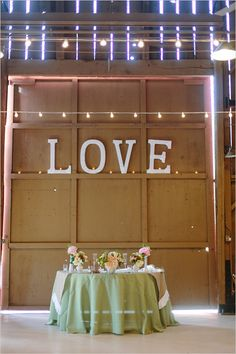 If scaled down, this would be a cute idea for a back drop on a fall wedding theme cake table!