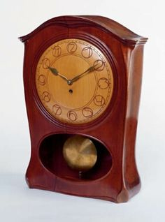"""Joseph Maria Olbrich (1867-1908) - Mantel Clock. Carved Mahogany with Maple Dial and Brass Hands & Movement. Designed for the Apartment of Dr. Friederich Spitzer. Vienna, Austria. Circa 1899. 19-1/2"""" x 13-3/4"""" x 6-1/4""""."""
