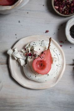 black sesame meringue nests with hibiscus poached pears.