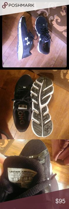 Men's size 10 Under Armour Black running shoes Black and white shoes, brand new, smoke free home.   Too small for my son and we never returned them. Under Armour Shoes Sneakers