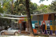 Urban Cabin is a small home renovating and interior decorating project from the Portuguese architectural studio Fabio Galeazzo, which turned an abandoned country house into bright and stylish contemporary home. Unique modernistic design and colorful exterior and interior decorating ideas are inspired by bright artworks by Tarsila do Amaral, the Brazilian artist.