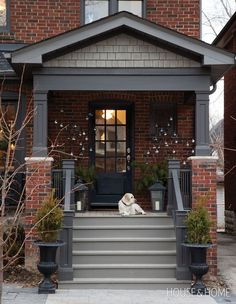 Branches adorned with silver and blue baubles add interest to this front porch. | Photographer: Donna Griffith | Designer: Ingrid Oomen