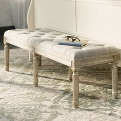 Showcasing turned feet, a distressed finish, and button-tufted seat, this country-chic bench is equally at home in your entryway or at the foot of your bed.
