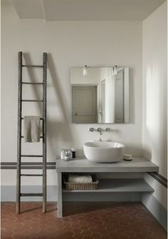 Poolhouse: interesting repurposing of ladder into a towel rack.