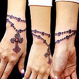 Also a cool tattoo - Rosary on the wrist! But good luck in a job interview with that one...