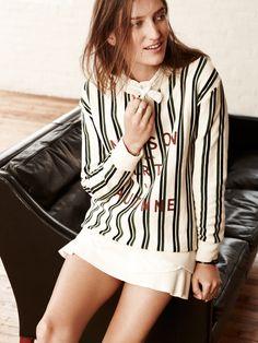 Madewell Maison sweatshirt worn with tie-neck blouse + boulevard skirt.
