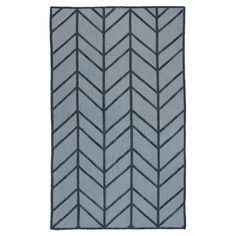 Anchor your living room seating group or define space in the den with this wool rug, featuring a chevron-inspired motif for eye-catching appeal....