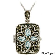 This sterling silver locket pendant features marcasites and marquise-cut gemstones. This sterling silver necklace comes with an 18-inch chain which secures with a spring ring clasp.