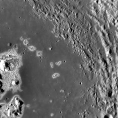 A Nursery for Hollows? Though the majority of the hollows are located on and directly around the central peak of Eminescu on Mercury, if you look closely you'll see that there are small hollows located on top of the knobby texture on the upper right side of the image.