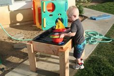 Tales of an Ordinary Housewife: HOW TO BUILD YOUR OWN WATER TABLE FOR $14