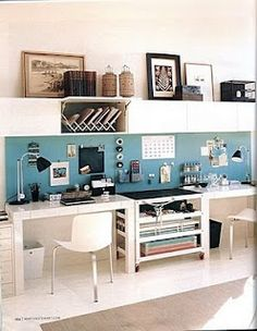 Cute home office idea. Note calendars etc mounted on wall to prevent clutter on desk top.