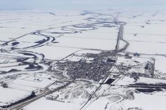 April 11, 2013.........Morris, Manitoba with its ring dike, waiting for the spring thaw and then another Red River flood. (Winnipeg Free Press)