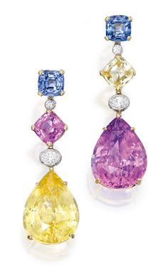Pair of 18 Karat Gold, Platinum, Multi-Colored Sapphire and Diamond Earclips: Suspending two pear-shaped sapphires, one pink sapphire weighing 22.21 carats and one yellow sapphire weighing 20.81 carats, accented by four cushion-cut sapphires in yellow, blue and pink hues weighing 6.62 carats, further accented by round and oval-shaped diamonds weighing .52 carat.