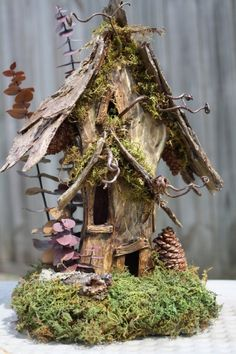 This tall fairy house was designed with the woodland forest in mind. The old two-story home has a rugged bark roof and twisted vines that creep out from the windows. Perfect for the fairy house collector. Fairy Garden Houses, Gnome Garden, Fairy Gardening, Fairies Garden, Organic Gardening, Fairy Village, Fairy Furniture, Furniture Design, Gnome House