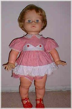 I had this Kissy Doll.  Squeeze her arms together and she kissed.  Sweet face.