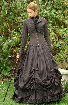 How to use Victorian styles in Steampunk costumes. From the Steampunk Fashion Guide to Skirts & Dresses: Bell Skirts - Woman in black pinstriped gothic victorian bell dress Costume Steampunk, Steampunk Clothing, Victorian Steampunk Dress, Steampunk Skirt, Victorian Costume, Victorian Era, Steampunk Fashion Women, Vestidos Vintage, Vintage Dresses