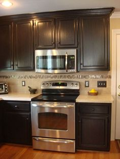Painted and Glazed Kitchen Cabinets - Painted cabinets with a dark glazed finish completed this kitchen remodel. It feels so much warmer and elegant now. Hard t…