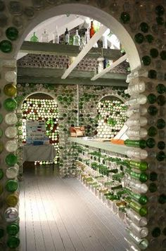 The Bottle Houses. The first bottle house was built in 1980 out of approximately 12,000 bottles, measuring 20 feet x 14 feet with three main sections. Its six gables and the patterns produced by the careful choosing of colours and sizes of bottles truly makes this a unique building.