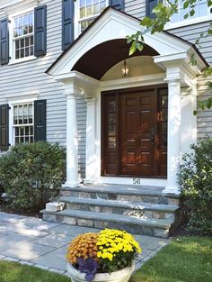 brown wooden colonial front door with beautiful portico with stones, vertical glass window of The Beauty of Simple Colonial Front Door Front Door Overhang, Front Door Porch, Front Porch Design, Front Door Entrance, Front Entrances, Front Doors, Front Entry, Front Porches, Entry Doors