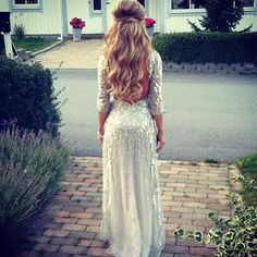 Blonde waves ith a half twist below her crown and a beautiful dress from Jennifer Bisse.
