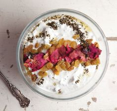Yogurt and Cucumber Dip (Mast-o Khiar). Topped with rose petals and golden raisins, this simple dip is an elegant mezze.