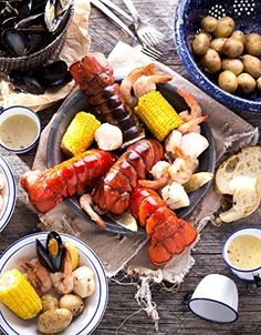 """4 Maine Lobster Tails, 16 shrimp, 4 half-ears of corn 30 mussels, 8 sea scallops, 20 baby potatoes """"This purchase was worth the money! It was easy to cook & a pleasure to eat."""" -Kelly Maine Lobsterman's Catch"""