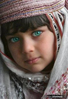 Afghan Girl. people photography, world people, faces. I can't believe that that shade of green exists naturally does not look real