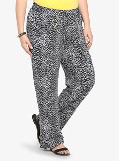 Set in a blurred black and white leopard print, this relaxed and flowy soft pant is chic enough for a night out but comfortable and lightweight enough for long days in the sun. A front drawstring and a touch of smocking on the back waistband shapes the silhouette. Front pockets.