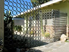 The gate was made in three sections, two fixed and one that swings. Made from recycled pipe that was cut into rings and welded together, each section was then galvanized and put into place.