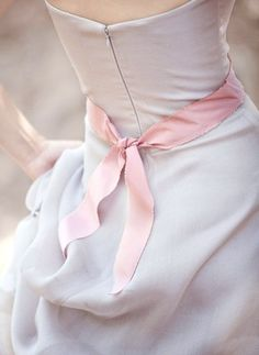 pink bow, white dress. photographer unknown.