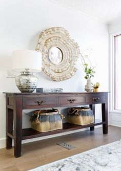 Entryway with a vintage dresser, and an eclectic mirror